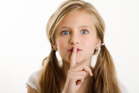 yo: 9 y.o. girl with secrecy expression.
