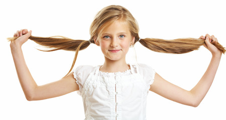 10 year old: Ten year old caucasian girl with long hair posing isolated on white.