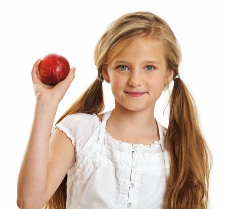 Ten year old caucasian girl with long hair posing isolated on white.