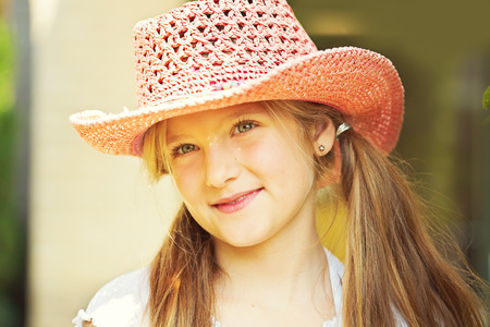 10 years old: Ten year old caucasian girl outdoors wearing summer hat.