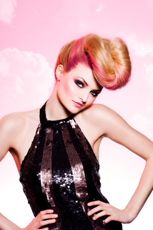 Pink-toned fashion image of a model wearing glitter top.