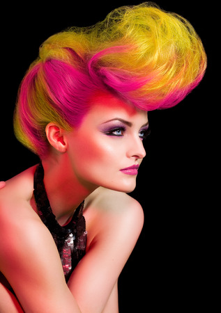 Fashion model with large hairstyle.