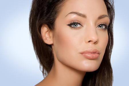 dark eyes: Model on blue background.