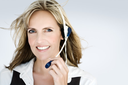 Smiling woman with headset. photo