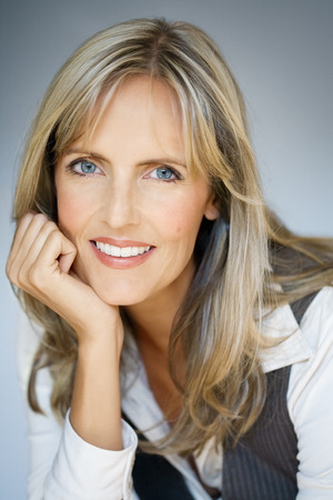 medium length: Smiling 40 y.o. woman. Stock Photo