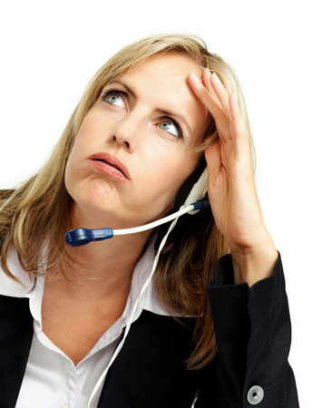Troubled woman from customer support with talking device. photo