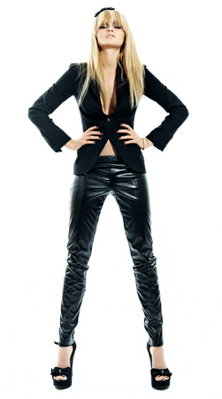 leather pants: Blonde model wearing leather pants. Stock Photo