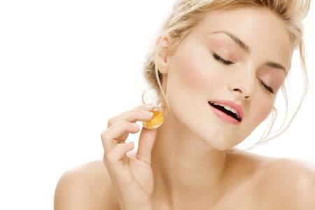 smelling: Young woman applying perfume. Stock Photo