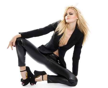 catsuit: Model posing in tight black outfit.