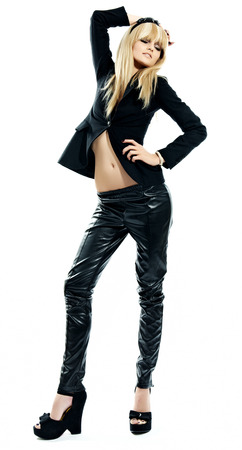 blazer: Blonde model wearing leather pants. Stock Photo