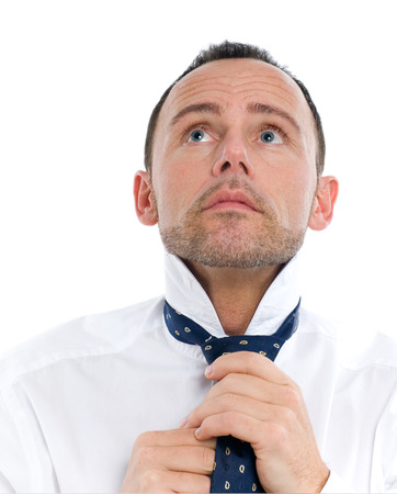 formal dressing: Man fixing his tie.