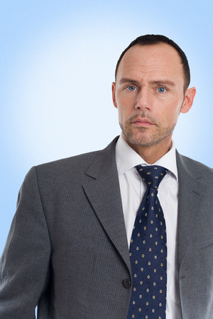 businesswear: Businessman on blue background.