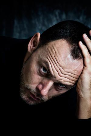 alcoholic man: Depressed intoxicated man.