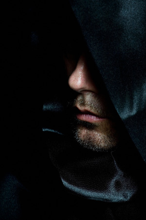 cassock: Monk in black hood. Stock Photo