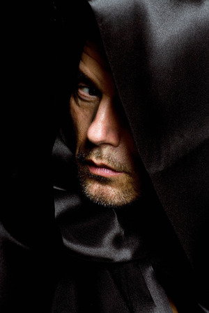 'dark ages': Monk in black hood. Stock Photo