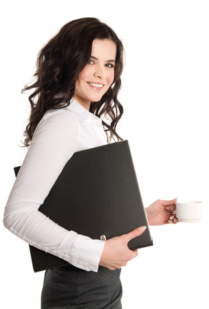 businesswear: Businesswoman on the go with coffee. Stock Photo
