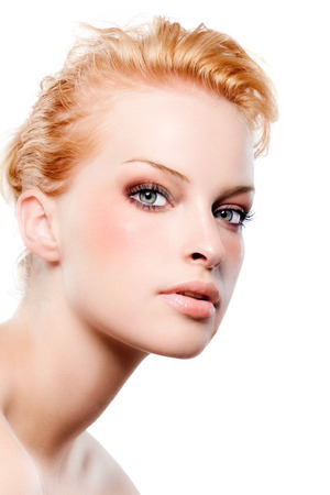 fashion photography: Red haired model with warm-toned make-up.