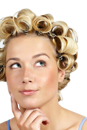 curlers: Young Caucasian woman wearing curlers.