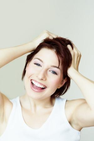 caucasian girl: Happy caucasian girl with short red hair.