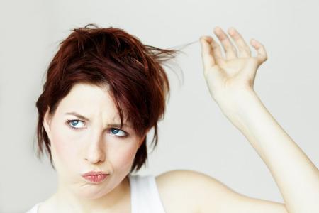 Closeup of a young woman unhappy with her hair. Banco de Imagens