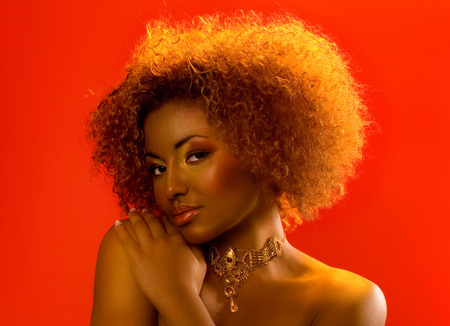 Beautiful woman of African ethnicity on red backround.