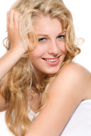 blond hair: Happy young woman with long blond hair.