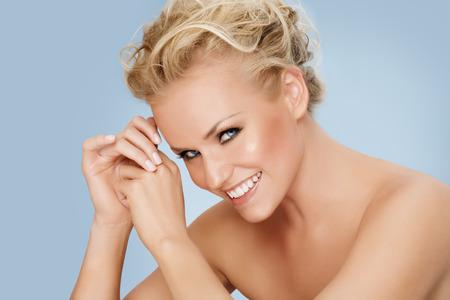 blonde  blue eyes: Model posing on blue background. Stock Photo