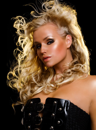 black hair blue eyes: Fashion model with long blond hair. Stock Photo