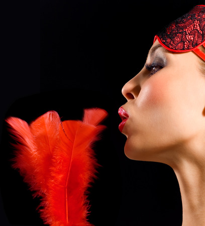 blindfold: Beautiful woman with red feather, red lipstick and red blindfold.