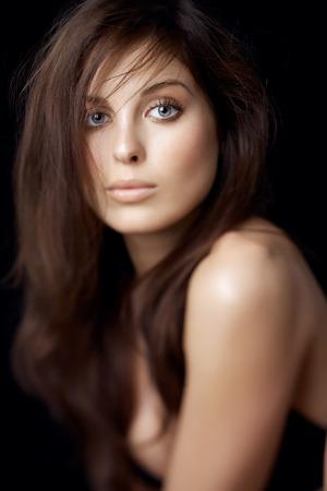 dark eyes: Portrait series of a Caucasian woman on black background. Shot with defocused effect.