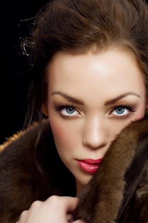 mink: Woman in mink coat. Stock Photo