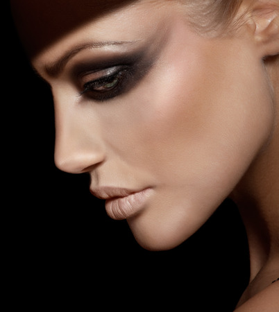 woman looking down: Profile of a sad woman with dark makeup. Stock Photo
