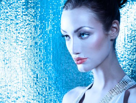 Beautiful pensive woman in blue tones.