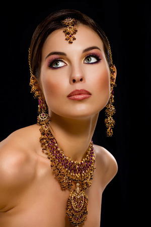 asian and indian ethnicities: Woman wearing Indian jewelry.