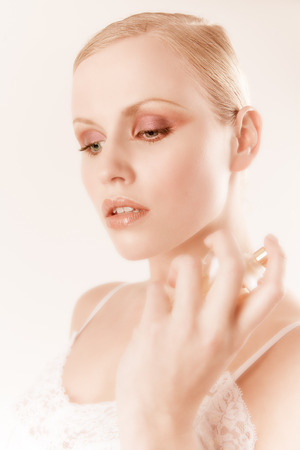 eau de toilette: Young woman with perfumes.
