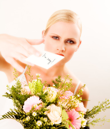 argument from love: She just got flowers with a note and looks angry.