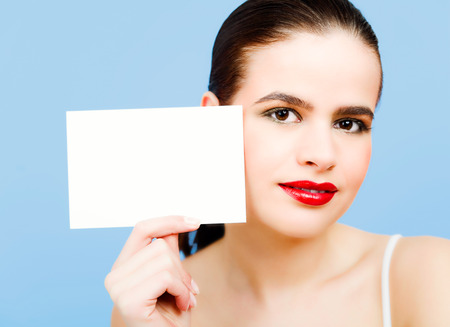 rasa: Young woman with blank piece of paper. Stock Photo