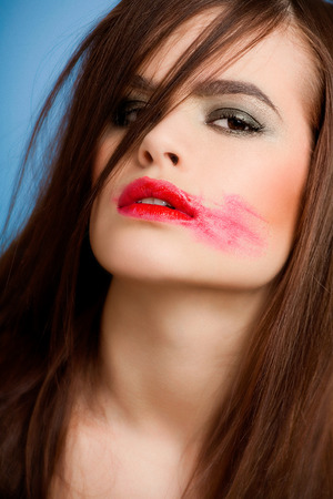 smudged: Young woman with bright red lipstick smudged. Stock Photo