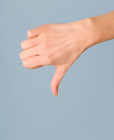 disapprove: Female hand with disapproval gesture. Stock Photo