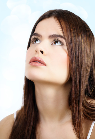 looking up: Beautiful woman looking up. Stock Photo