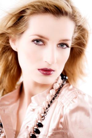 blouse: Model wearing pink silk blouse. Stock Photo