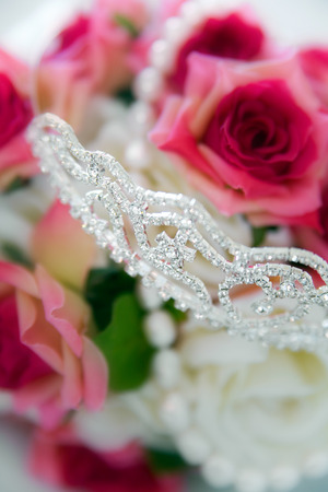 chrystals: Bridal arrangement with flowers and tiara. Shallow DOF with focus on tiara.