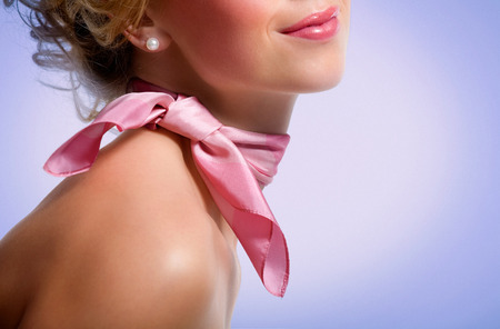 neck scarf: Woman wearing pink scarf.