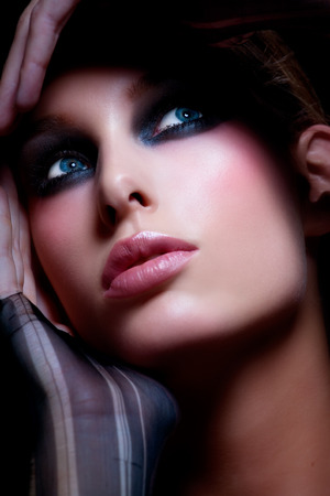 smoky eyes: Model with smoky eyes.