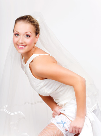 panty hose: Bride posing in white highs with little blue bow.
