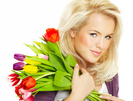 dutch girl: Happy young Dutch woman with tulips.