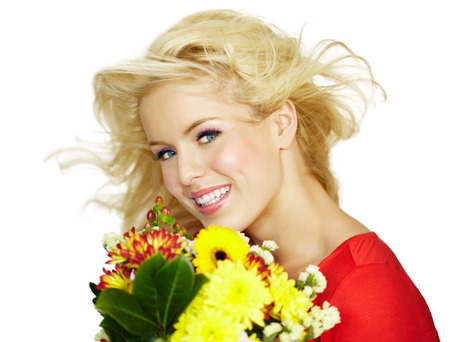 dutch girl: Happy young woman with flowers.