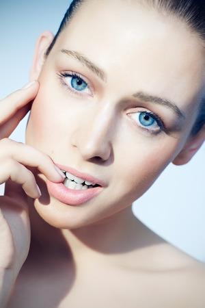 black hair blue eyes: Closeup of a model with blue eyes.