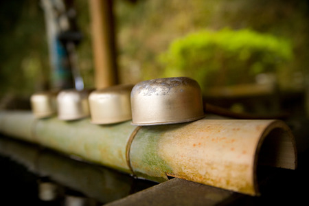 purifying: These cups are used for purifying hands before entering buddhist shrine. Okawachiyama village in Japan. Stock Photo