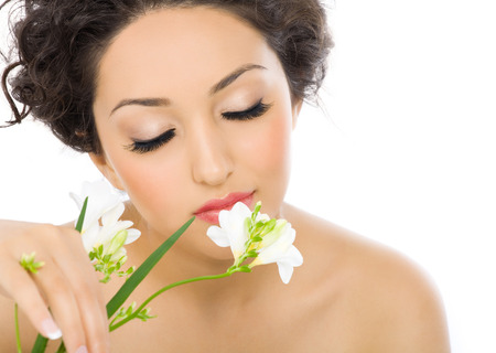 Woman smelling a flower. photo